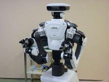 Роботы NEXTAGE открывают выставку робототехники IREX-2009 в Японии
